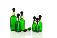 Green glass bottle with dropper