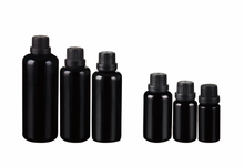 Dark violet glass essential oil bottles